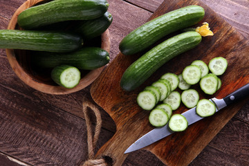 Fresh and sliced cucumbers. Sliced cucumbers on a cutting board. cucumbers for diet and healthy eating