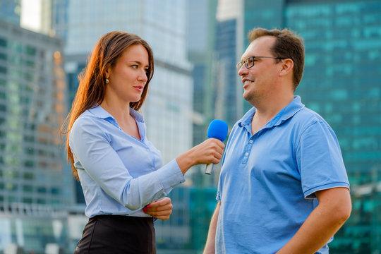 Young girl TV reporter interviews a man