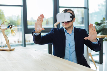 Smart handsome businessman being in 3d reality