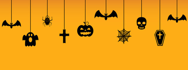 Halloween hanging ornaments on orange background