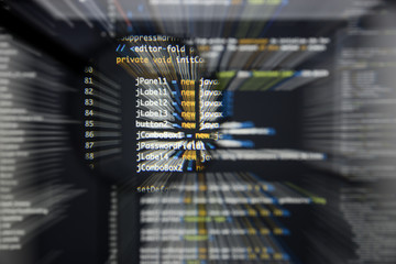 Real Java code developing screen. Programing workflow abstract algorithm concept. Lines of Java code visible under magnifying lens with moviment effect