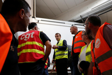 French President Emmanuel Macron talks with Whirlpool employees during a visit at the company's factory in Amiens