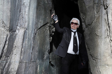 German designer Karl Lagerfeld appears at the end of his Spring/Summer 2018 women's ready-to-wear collection show for fashion house Chanel at the Grand Palais during Paris Fashion Week