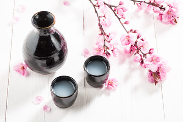Tasty and strong sake with flowers of blooming cherry