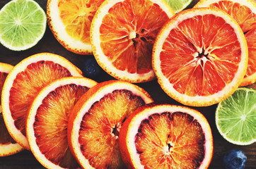 Citrus vitamin mix - bloody oranges and limes, top view