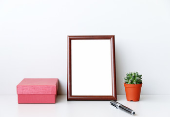 mock up Workspace picture frame on desk In modern office