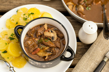 Beef stew goulash with bacon and mushrooms