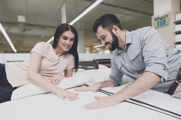 The couple came to a large mattress store to choose their own mattress. They lay down on one of them