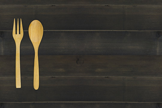 wooden spoon and fork on wooden table