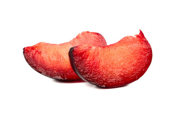 Two slices red plum