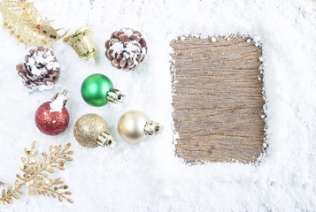 Christmas concept. Christmas decoration on snow with wooden background