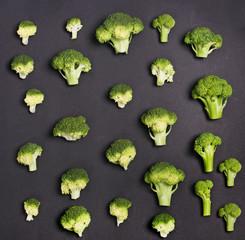 A broccoli pattern on a gray background.