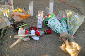 Flowers and candles are seen by site of the Route 91 music festival mass shooting outside the Mandalay Bay Resort and Casino in Las Vegas