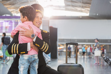 Little boy meeting father-airman in airport