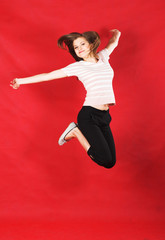girl jumping of joy over red
