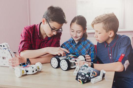 Stem education. Kids creating robots at school