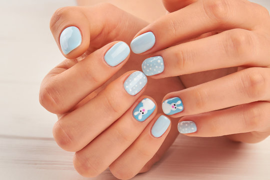 Trendy winter manicure close up. Female hands with delicate manicure close up. Winter nail art.
