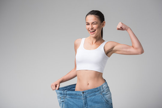 Happy young woman lost her weight