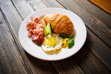 Fresh croissant with ham and salad