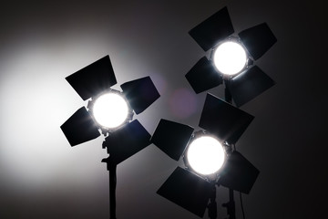 Several reflectors on the black background in photo studio.