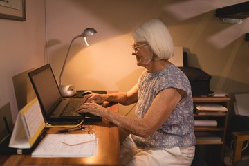 Senior woman working on laptop