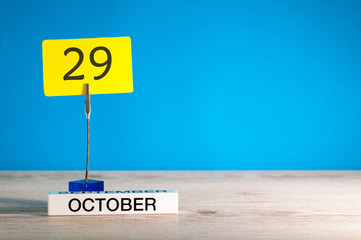 October 29th. Day 29 of october month, calendar on workplace with blue background. Autumn time. Empty space for text