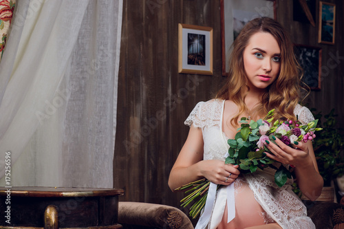 a03836804 young pregnant women girl in lingerie and bouquet