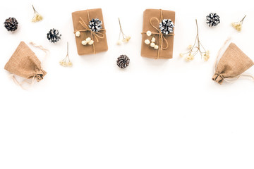 Christmas gift, branches, white christmas decoration, white pine cone on white background. Top view, flat lay