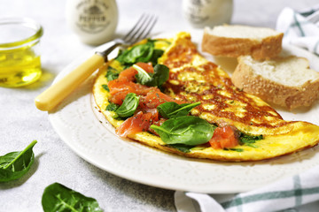 Omelette stuffed with spinach and salted salmon.