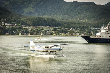 JUNEAU, ALASKA - SEPT 3, 2017: Sea planes or prop planes are taking off and landing in the port of Juneau, Alaska