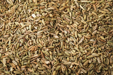 Heap of fennel seeds background