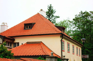 A view of typical Prague house with red tile roof