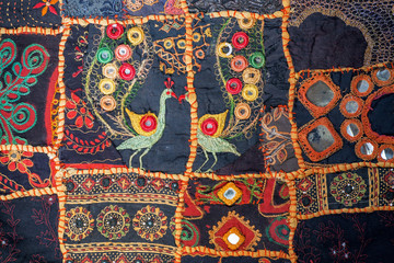 Vintage homemade patchwork background. Colorful ethnic handmade details and patterns on texture of old blanket. Patch work design art surface
