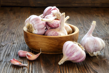 Garlic in a wooden bowl Wall mural