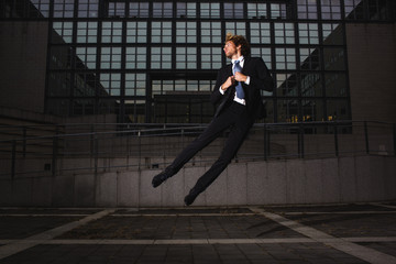 Young businessman floating in the air