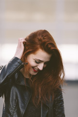 Happy young woman with red hair