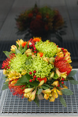Autumn bouquet of chrysanthemum, carthamus, nutans, hypericum and alstroemeria flowers