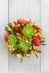 Autumn bouquet of flowers on the tiles