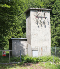 electric cabin in the woods for energy production near a dam