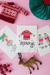 Hand Painted Christmas Cards on a Pink Background