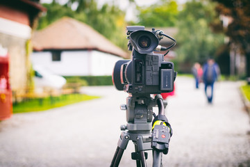 movie camcorder on a tripod while shooting a street