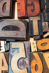 Closeup of vintage letters for sold in a marketplace.