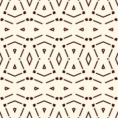 Seamless pattern with symmetric geometric ornament. Striped abstract background. Ethnic and tribal motifs.