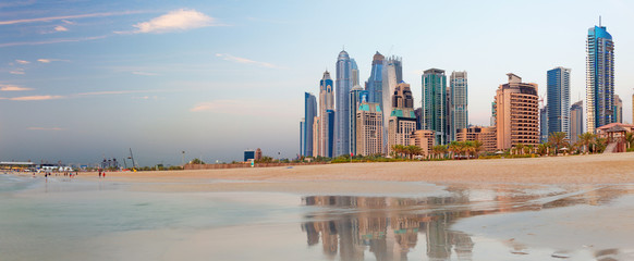 Keuken foto achterwand Dubai Dubai - The Marina towers from beach in evening light.