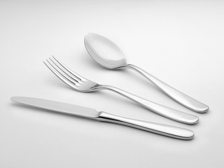 Silver cutlery on white