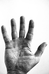 Grainy black and white of a middle aged male hand