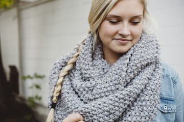 Pretty young woman wearing grey knit scarf