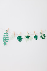 Paper Leaves Hanging on a String