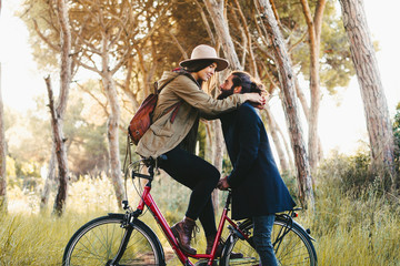Lovers on a bicycle in the forest.