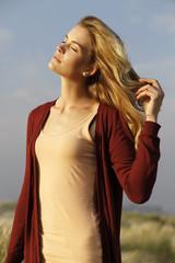 young woman enjoying the last rays of sun